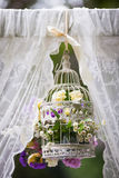 Beautiful wedding decoration, white cage with flowers at aisle Royalty Free Stock Photography