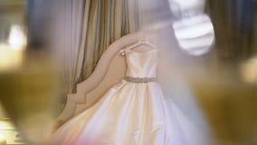 Beautiful wedding dress in bedroom stock video footage