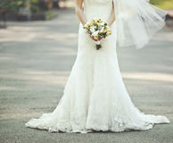 Beautiful wedding dress. Bride holding a bouquet Stock Photography