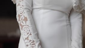 Beautiful wedding dress on charming bride. Element of jewelry.  stock video footage