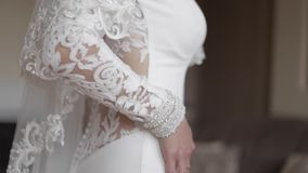Beautiful wedding dress on charming bride. Element of jewelry.  stock footage
