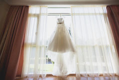 Beautiful wedding dress hanging in the bride`s room Stock Image