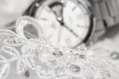 Beautiful wedding dress and white watch Royalty Free Stock Image