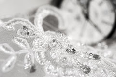 Beautiful wedding dress and white watch Stock Photos