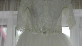Beautiful Wedding Dress on the Window in a Home stock video