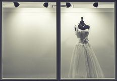 Wedding dress in the window of shop royalty free stock photo
