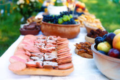 Beautiful wedding feast in nature, abundance of meals on a table. Royalty Free Stock Image