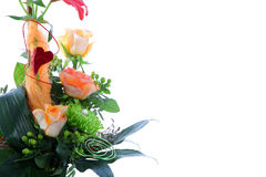 Beautiful wedding flower arrangement. With roses greenery and berries together with a wire spiral and red heart Royalty Free Stock Images