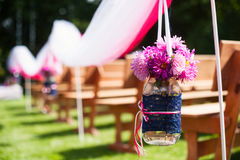 Beautiful wedding flower arrangement of seats on ceremony Royalty Free Stock Image