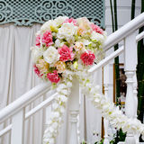 Beautiful wedding flower decoration at stairs Stock Photos