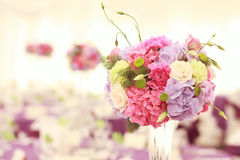 Beautiful wedding flower decoration table arrangement. Pink yellow purple petals Stock Photos