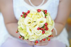 Beautiful wedding flowers bouquet. Bride holding beautiful wedding flowers bouquet Royalty Free Stock Photography