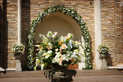 Beautiful wedding flowers outside a church Royalty Free Stock Photography