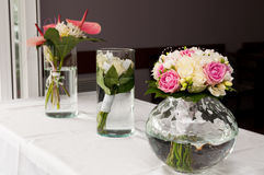 Beautiful wedding flowers on white table. Beautiful wedding flowers placed on white table royalty free stock photo