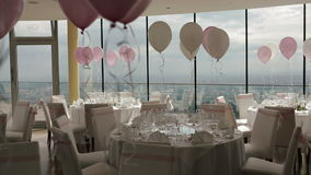 Beautiful wedding hall decorated with balloons, ribbons and flowers stock video footage