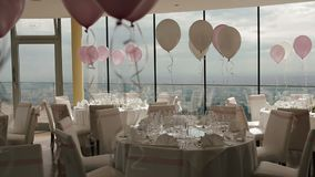 Beautiful wedding hall decorated with balloons, ribbons and flowers.  stock video