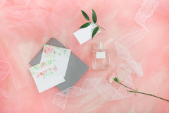 Beautiful wedding invitation. Details from polygraphy, flowers a. Nd perfumes. Top view Stock Photography