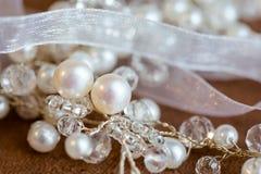 Beautiful wedding jewellery earings necklace. Beautiful earings and necklace jewellery of the Bride before wedding - romantic detail Stock Photo