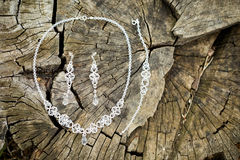 Beautiful wedding jewellery earings necklace. Beautiful earings and necklace jewellery of the Bride before wedding - romantic detail Stock Photography