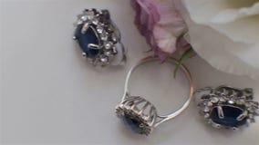 Beautiful wedding jewelry.Ring, earrings. stock video footage
