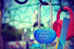 Beautiful wedding locks on the iron tree of love. Royalty Free Stock Photography