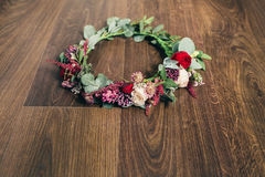 Beautiful wedding red rose flower crown on wooden background Royalty Free Stock Images