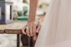 Beautiful wedding ring on bride hand. Closeup Stock Images