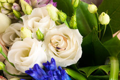 Beautiful wedding ring in a wedding bouquet of flowers Stock Photo