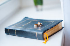 Beautiful wedding rings on blue bible bookmark. S Royalty Free Stock Images
