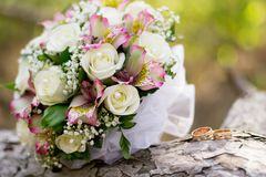 Beautiful wedding rings with bouquet of flowers.Declaration of love, spring. Wedding card, Valentine`s Day greeting. Wedding royalty free stock photography