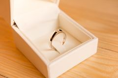 Beautiful wedding rings in box on wooden background stock image