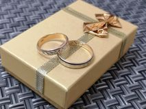 Beautiful wedding rings for young. Beautiful wedding rings lie on the gift box and wait for the turn to put them on your fingers royalty free stock photo