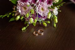 Wedding rings and bouquet royalty free stock image