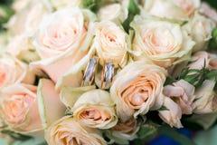 Wedding rings on wedding bouquet. Beautiful wedding rings on wedding bouquet outdoors Stock Images