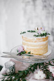 Beautiful wedding round cake with floral decorations. Royalty Free Stock Photography