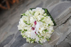 Beautiful wedding round spring flowers bouquet. Pretty white spring flowers bouquet, very formal but delicate, floral arrangement ideas for the bride and royalty free stock images