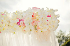 Beautiful wedding set up with pink pionies and orchids Royalty Free Stock Image