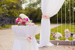Beautiful wedding set up with pink pionies and orchids Stock Images