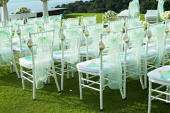 Beautiful wedding set up. Wedding ceremony on green lawn in the Stock Image