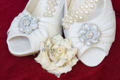 Beautiful wedding shoes with pearls and flower Royalty Free Stock Image