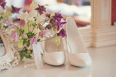 Beautiful wedding. Stylish and fashionable shoes bride belt tiles. delicate flowers Stock Photo