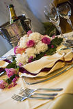 Beautiful wedding table. With champagne, flowers and glass Stock Photo