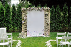 Beautiful wedding trellis decorated with flowers and congratulation on banner Stock Photos
