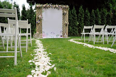 Beautiful wedding trellis decorated with flowers and congratulation on banner Royalty Free Stock Image