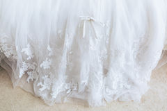 Beautiful wedding with white hem dress bow, closeup. Beautiful wedding with white hem dress bow. Closeup royalty free stock photography