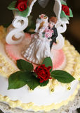 Beautiful weeding cake. With girl and boy figurines Stock Photography