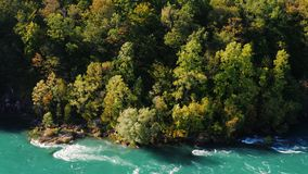 Beautiful weight on a steep mountain slope. Downstream is the Niagara River. Nature of the USA and Canada. 4K 10 bit