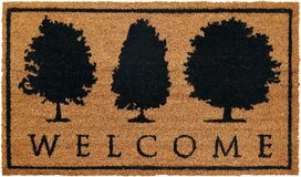 Beautiful welcome doormat peach color with three black tree. Beautiful welcome doormat peach color with black tree Isolated on a White Background royalty free stock images