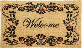 Beautiful welcome peach color coir doormat with flower border. Isolated on a White Background royalty free stock image