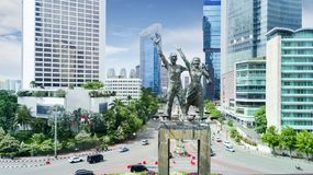 Beautiful Welcome Statue with office building. Beautiful aerial view of Welcome Statue with office building in Jakarta downtown Stock Photos
